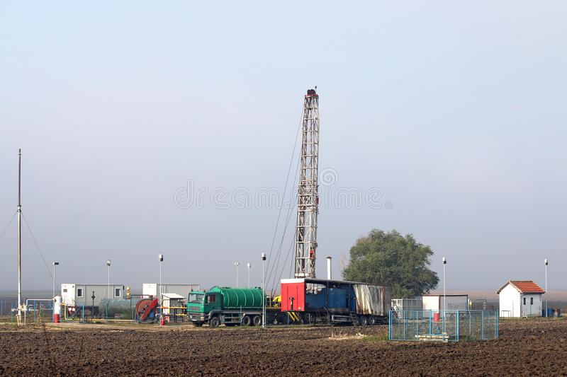 Oil drilling rig. On oilfield royalty free stock photo