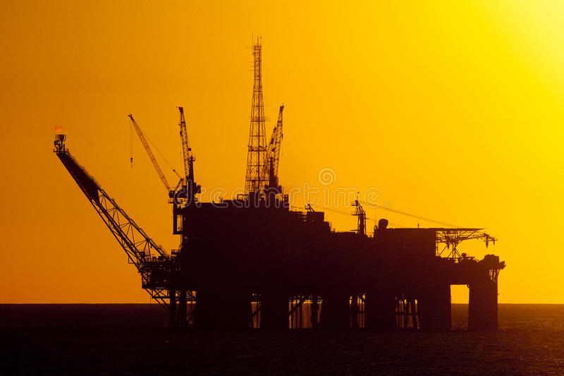 Oil Drilling rig in silhouete royalty free stock photography