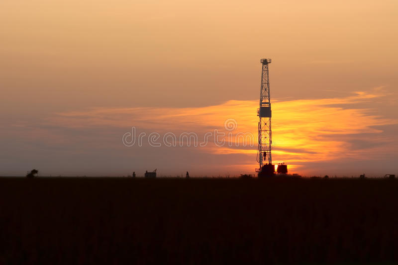 Oil Drilling Rig and Sunset. Oil Drilling Rig against an evening sky royalty free stock images