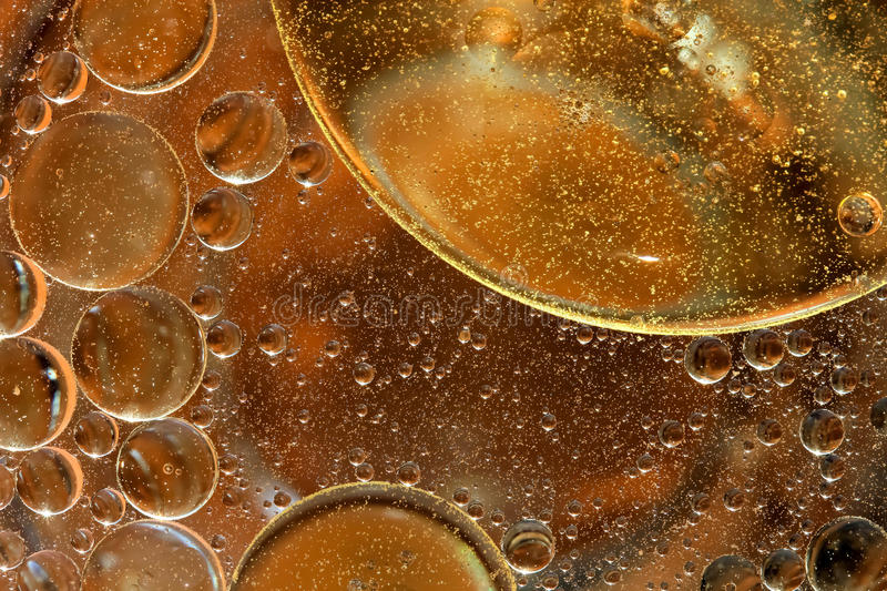 Oil drops on a water surface stock photo