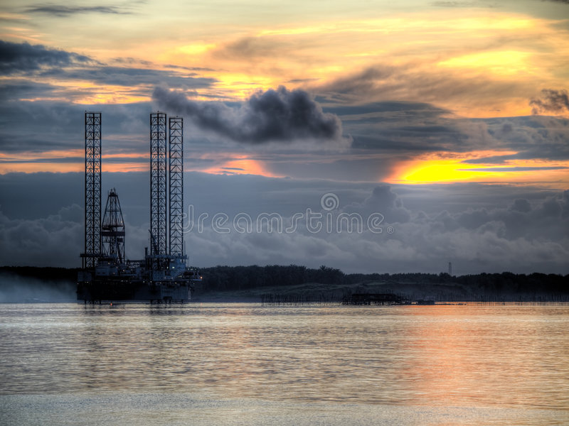 Download Oil Exploration Rig At Dawn Stock Image - Image: 5867301