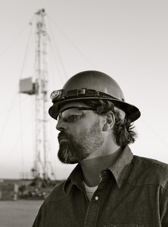 Oil field. Worker making sure things go smooth stock photos