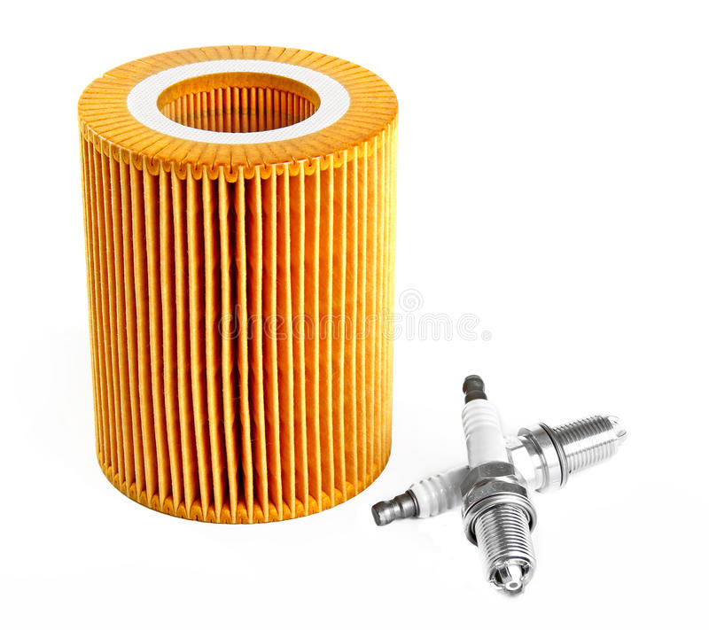 Oil filter and two spark plugs royalty free stock images