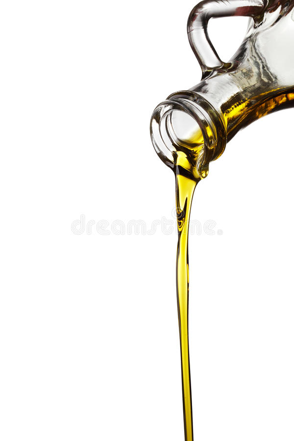 Oil flowing from carafe. Olive oil flowing from carafe isolated on white background royalty free stock image