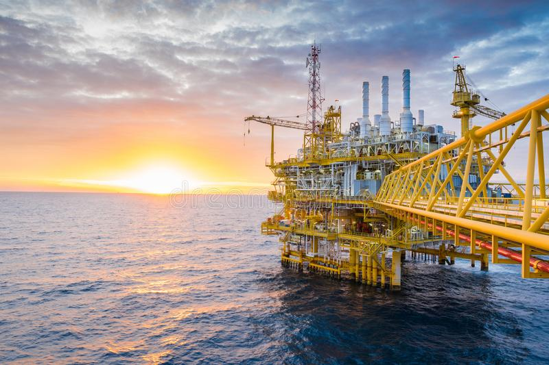 Oil and gas central processing platform in sun set in the gulf of Thailand, Oil and gas petroleum business stock images