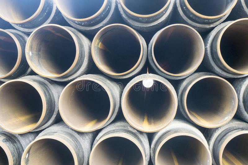 Oil and gas. Concrete rounded pipes stacking on deck for underwater oil and gas purpose royalty free stock photo