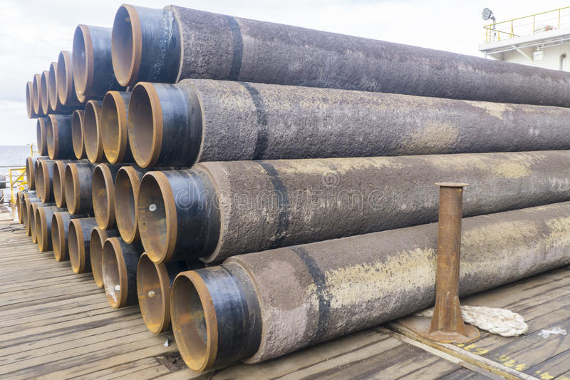 Oil and gas. Concrete rounded pipes stacking for underwater oil and gas purpose royalty free stock image