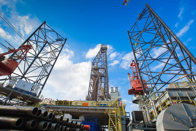 Oil and gas drilling rig. Work over remote wellhead platform to completion oil and gas produce well by using drilling bit which made from carbide or diamond at stock photos