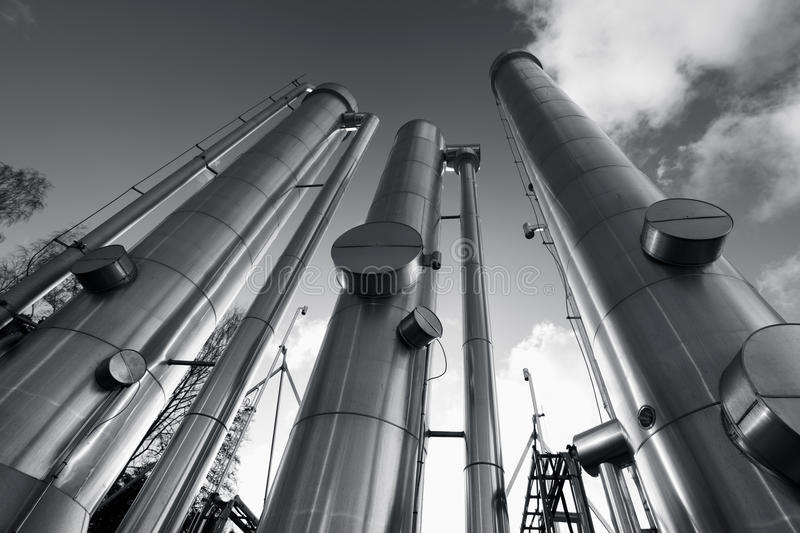 Oil, gas and fuel pipes. Large gas, oil and fuel pipes, pipelines, duplex dark silver toning concept stock photo