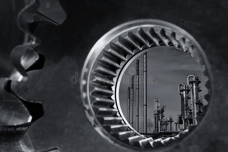 Oil and gas through a giant gear axle stock photos