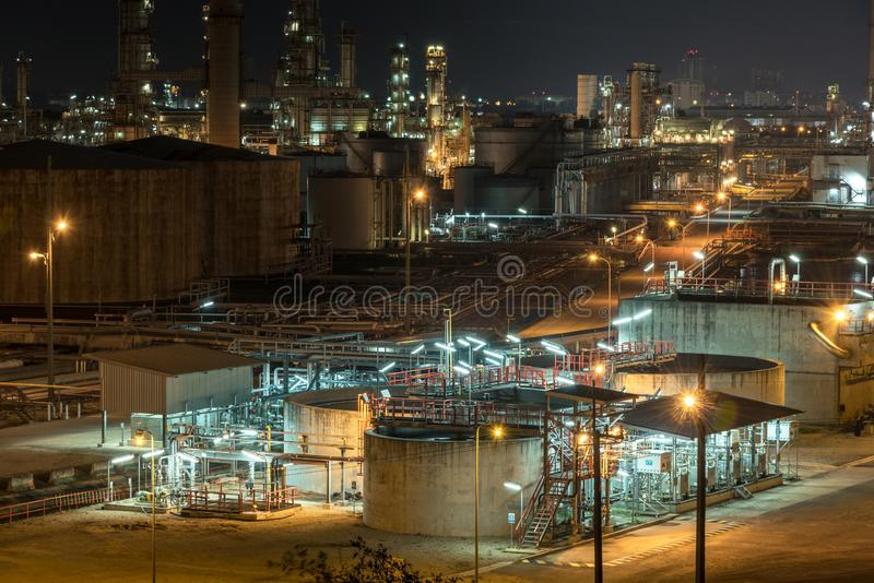 Oil and gas industrial,Oil refinery plant form industry,Refinery factory oil storage tank and pipeline steel with sunset and stock photography
