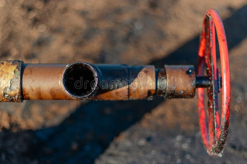 Oil, gas industry. Group wellheads and valve armature. Oil, gas industry. Group of wellhead and reinforcement valves. Environmental pollution stock photography