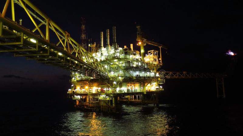 Oil and gas industry and hard work at night time. Offshore construction platform. Oil and gas industry and hard work. Offshore construction platform for stock images