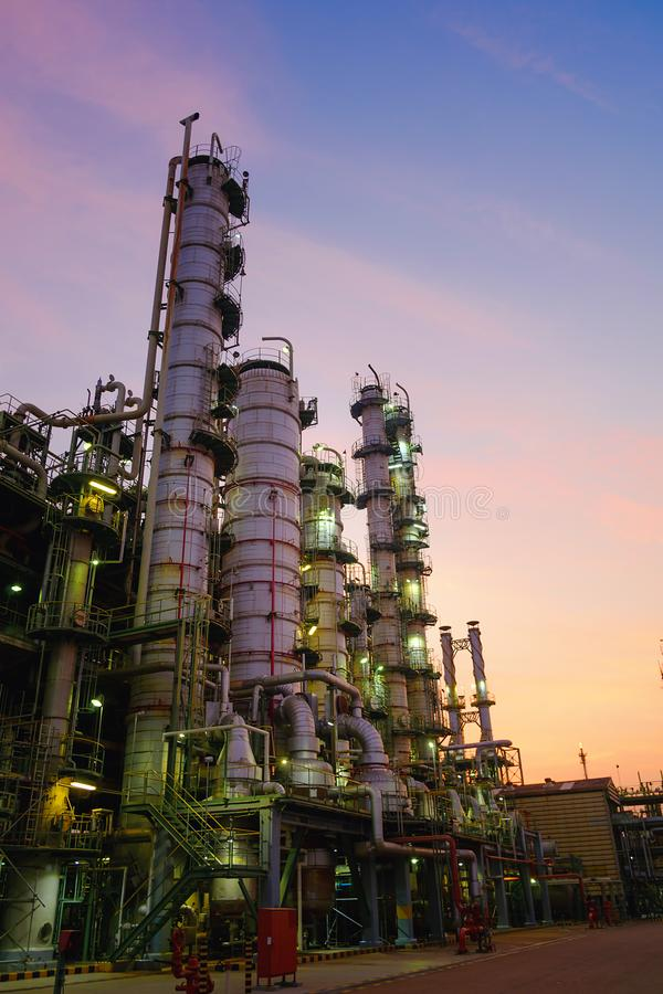 Oil and gas. Refinery plant or petrochemical industry on sky sunset background, Factory at evening, Manufacturing of petroleum industrial plant stock photo