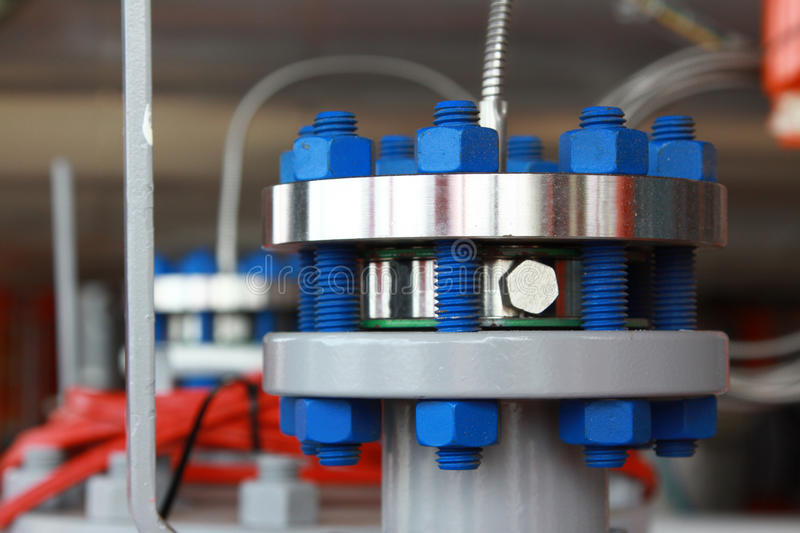 Oil and gas pipes flange with stud bolt. On oil and gas platform stock photos