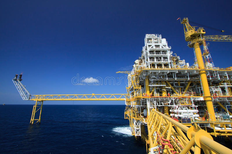 Oil and gas platform in offshore industry, Production process in petroleum industry, Construction plant of oil and gas industry. Heavy work stock image