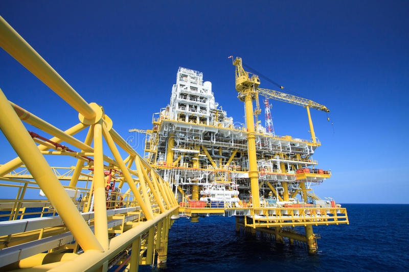 Oil and gas platform in offshore industry, Production process in petroleum industry, Construction plant of oil and gas industry. Heavy work royalty free stock photography