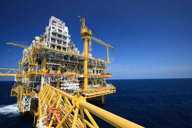 Oil and gas platform in offshore industry, Production process in petroleum industry, Construction plant of oil and gas industry royalty free stock photography