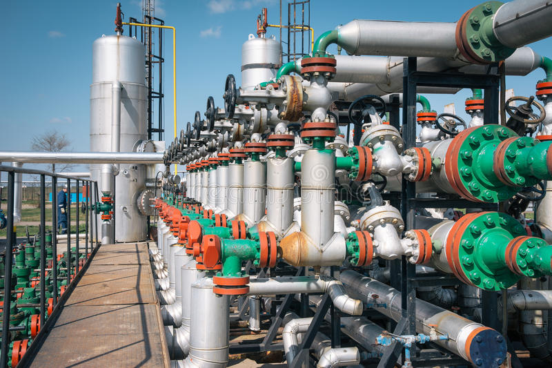 Oil and gas processing plant. On the blue sky royalty free stock image