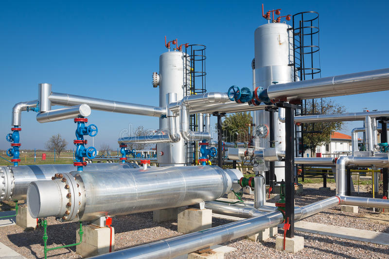 Oil and gas processing plant. On the blue sky stock photos