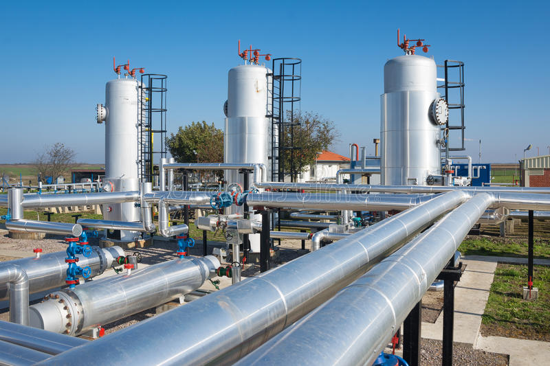 Oil and gas processing plant. On the blue sky stock photography