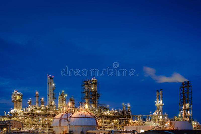 Oil and gas refinery. Plant or Petrochemical industrial plant on blue sky twilight background, Glitter lighting factory of petroleum plant with dawn sky stock image