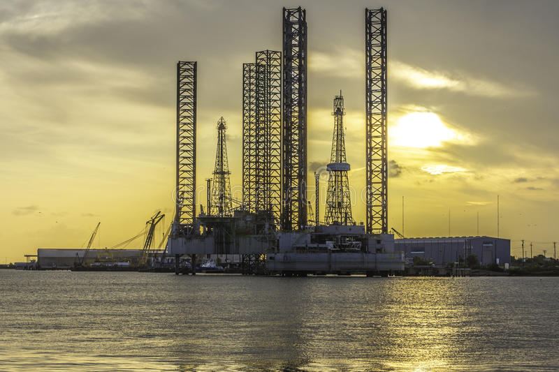 Oil and Gas Refinery. Photo of a sunset behind an oil and gas refinery station near the water royalty free stock photography