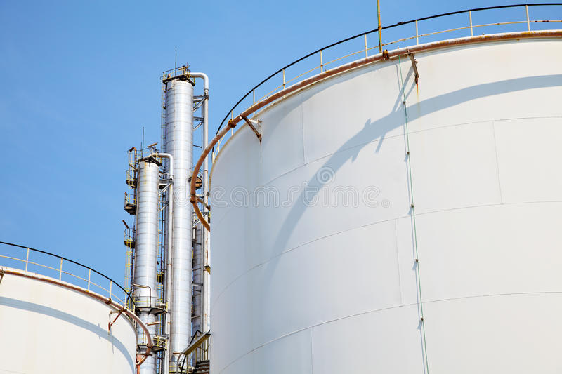 Oil and Gas Refinery Plant. With distillation column and tank royalty free stock image