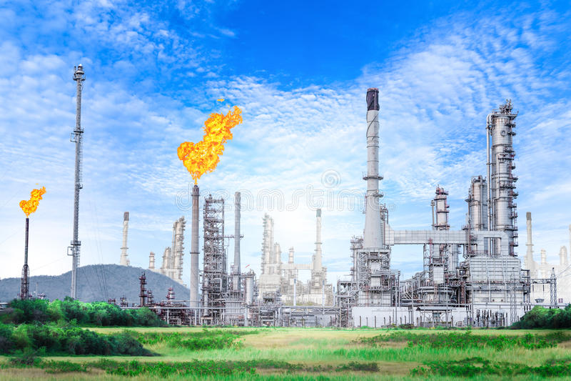 Oil and gas refinery plant with with flare stack on blue sky background. Petrochemical plant , Petroleum royalty free stock image