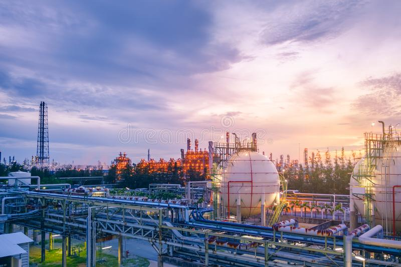 Oil and gas refinery. Gas storage sphere tanks and pipeline in oil and gas refinery industrial plant on sky sunset background stock photography