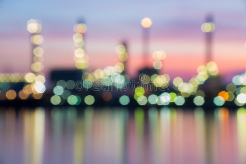 Oil and gas refinery at twilight time. Blurred Photo bokeh royalty free stock photos