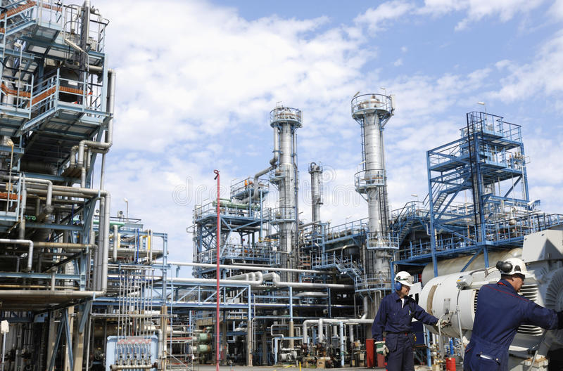 Oil and gas refinery with workers royalty free stock photos
