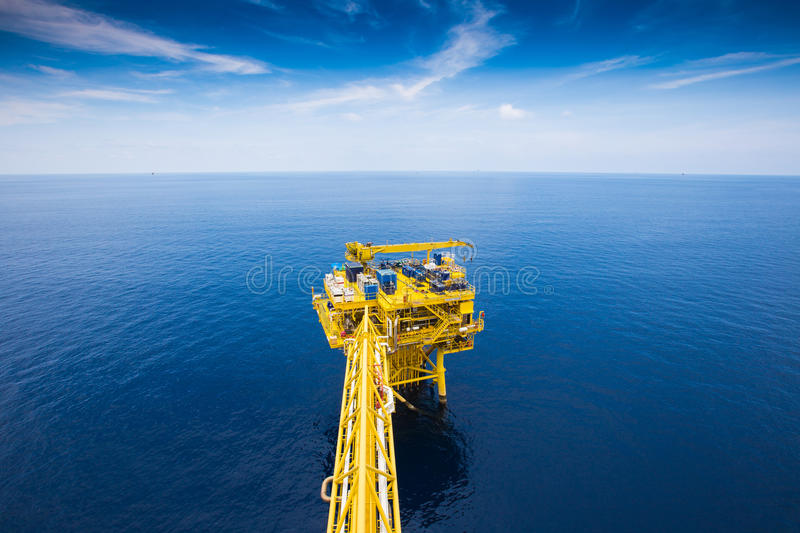 Oil and gas remote wellhead platform produced gas and crud oil. Oil and gas remote wellhead platform near central processing platform stock photography