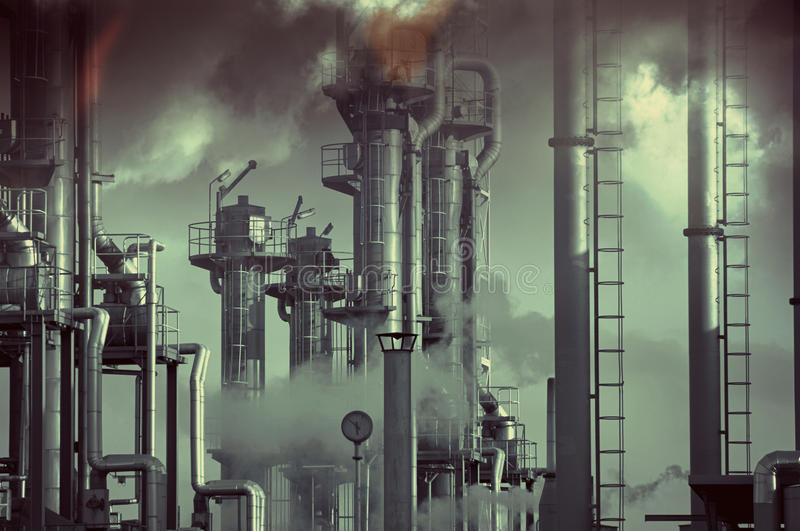 Oil and gas, toxic and pollution. Insudtrial toxic clouds and pollution over an oil and gas refienry, burning safety flames stock photo