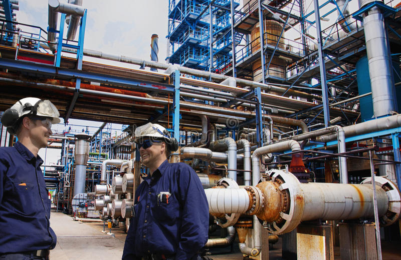 Download Oil And Gas Workers Inside Large Refinery Industry Stock Photo - Image of pollution, engineer: 44790032