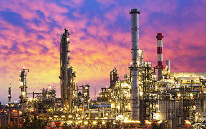 Oil Industry - refinery factory. At sunset royalty free stock image