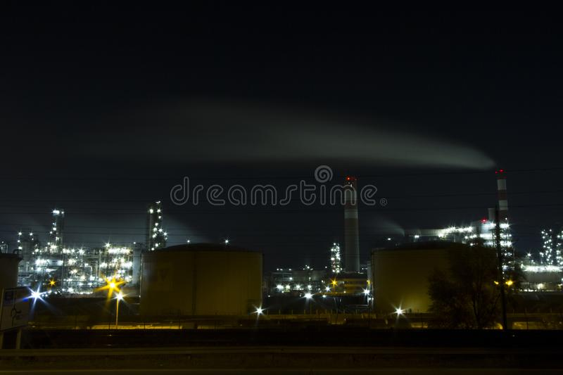 OIL INDUSTRY REFINERY PETROL FACTORY IN NIGHT LIGHT. VIENNA AUSTRIA stock photo