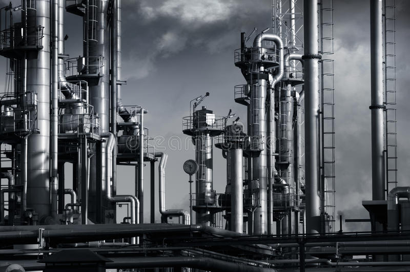 Oil industry, smoke and clouds stock photography