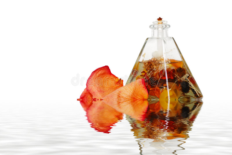 Download Oil Lamp And Rose Petals With Water Stock Photo - Image of life, essence: 4911192