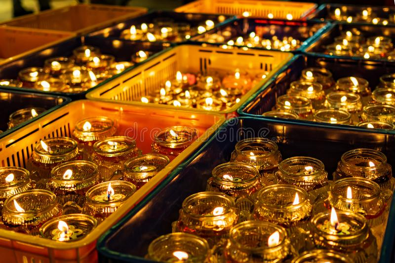 Oil lamps in a Buddhist temple in Singapore during Vesak Day / Buddha Day celebrations. Oil lamps give off a warm festive glow in a Buddhist temple in Singapore stock photography