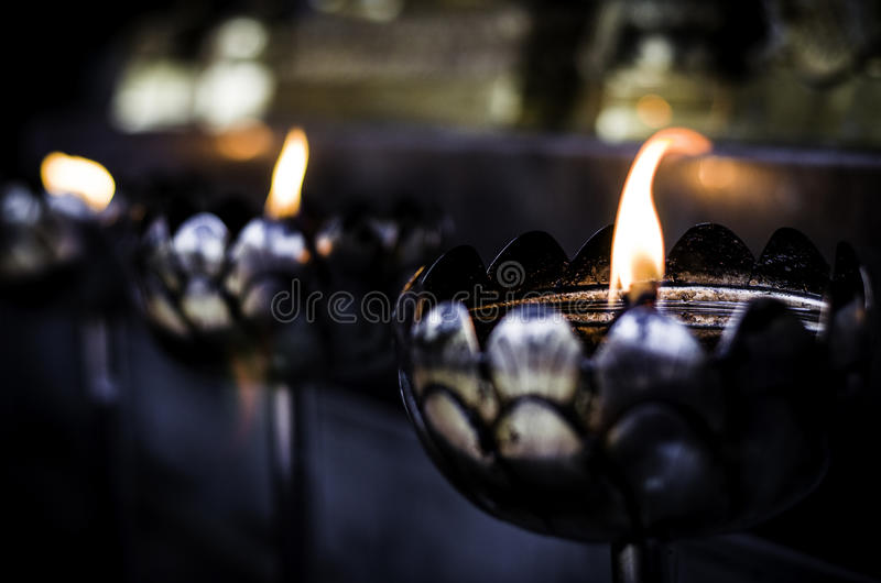 Oil Lamps burning at Temple stock photography