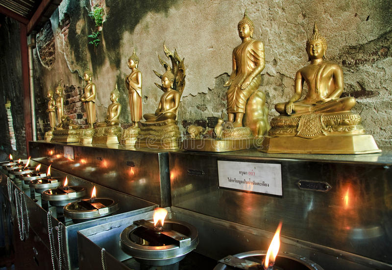 Oil lamps and figurines of Buddha in Ayutthaya stock image