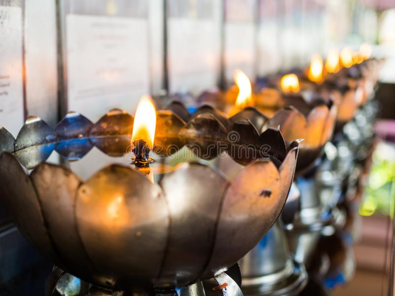 Oil lamps, silver lotus shape holder royalty free stock photos