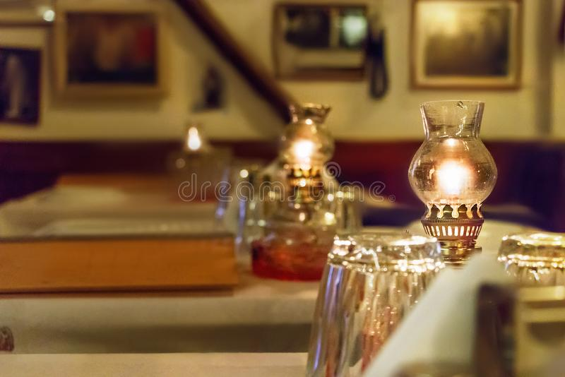 Oil lamps on a table of a greek tavern, selective focus. stock photos