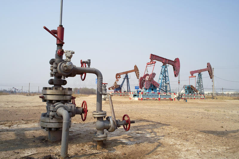 Oil latch and pump jack royalty free stock image