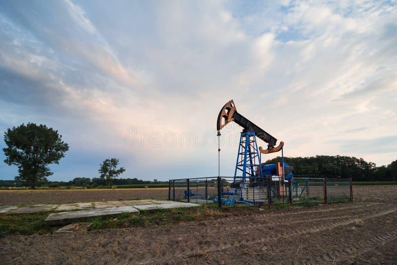 Oil mine at sunrise. Oil mine industry at sunrise stock image