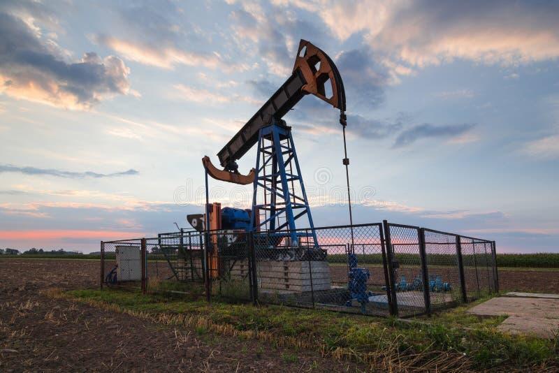 Oil mine at sunrise. Oil mine industry at sunrise stock photo