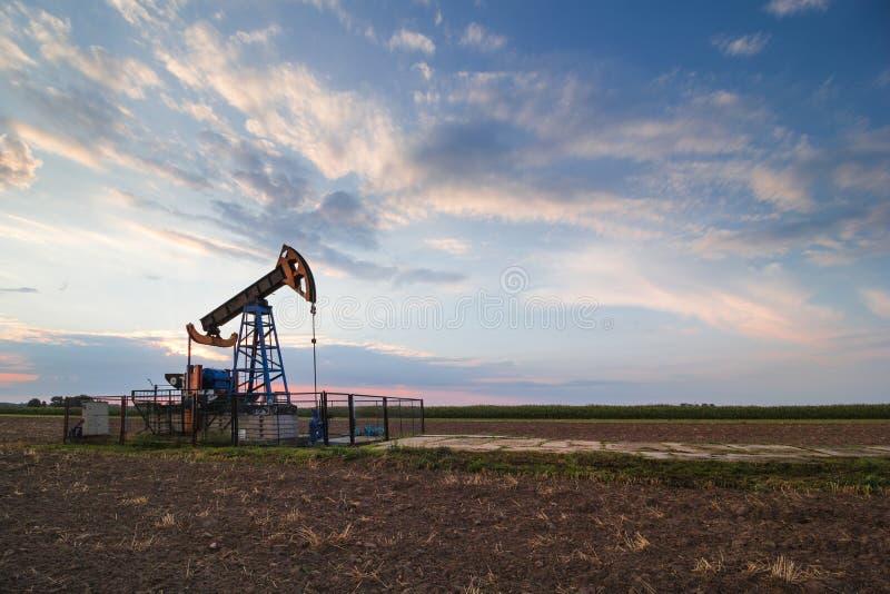 Oil mine at sunrise. Oil mine industry at sunrise royalty free stock image