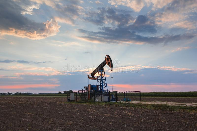 Oil mine at sunrise. Oil mine industry at sunrise stock photos