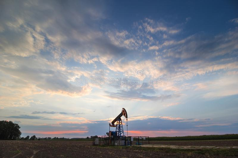 Oil mine at sunrise. Oil mine industry at sunrise royalty free stock images